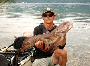 Photo of kayak fishing guide Howard holding up a nice ling cod